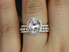 This is my exact dream ring. Jessica & Petite Bubble Breathe Oval Peach Sapphire and Diamonds Halo TRIO Wedding Set (Other metals and stone options available) Wedding Engagement, Wedding Bands, Engagement Rings, Wedding Rings Vintage, Wedding Jewelry, Trio Wedding Sets, Peach Sapphire, Sapphire Wedding, Natural Sapphire