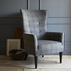 plaid chair and a cozy reading corner