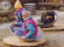 The Wobble Dish has room for one to three small children and allows them to enjoy themselves while wobbling and rocking around. By shifting one´s weight, one can rock to and fro, sway or roll in a circle while the dish moves around the pivot point. All this can be happen simultaneous and, sometimes something happens which was not expected. This is great fun, even for small children. Coordination of movements and readiness to take risks are expected through play.