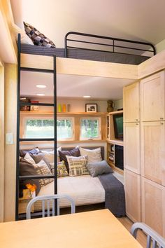 A luxe cabin-style tiny house on wheels, named The Traveler, from ESCAPE Homes.