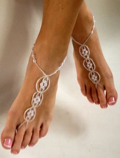"I am supposed to be barefoot when I say ""I do""... what do you gals think of these?  Pearl Destination Wedding Shoes White Beaded by BareSandals, $32.00"