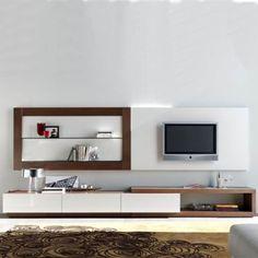 Mueble de televisión moderno con 3 cajones y hueco asimétrico, que sirve a la vez de zócalo, abarcando todo el mueble. Realizado en madera de roble.