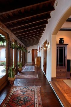 With rich wood accents and woven textures throughout, this Spanish Colonial Revi… – Round Rugs Living Room Hacienda Style Homes, Spanish Style Homes, Spanish House, Spanish Colonial Kitchen, Spanish Style Interiors, Spanish Home Decor, Dream Home Design, Home Interior Design, House Design