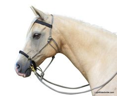 LightRider Bridle - Rope Natural is perfect for starting young horses, trail and endurance riding and as a multi use halter/bridle. Looks great in the black/gold zig zag rope and includes reins too for only $99. http://www.naturalhorseworldstore.com/lightrider-bridle-rope-natural/