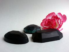 The charcoal helps suck up excess oil. When I use this soap I make a nice thick lather in my hands, put it onto my face and let it sit for a minute (almost like a mask) and then rinse it off.  Because activated charcoal removes toxins, it can help reduce the instances of acne and other skin impurities you might suffer from. It also works wonders for completely removing makeup.  This listing is for 1 bar of soap / Different diamond shapes