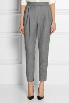 Featuring a subtle houndstooth pattern, Fendi's wool pants are a classic wardrobe staple. Front pleats, slant pockets and split cuffs lend to the flattering fit and drape of this tapered design. Wear yours at the office with a tucked-in blouse and pointed pumps.