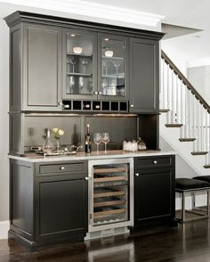 Suzie: Venegas and Company - Glossy black butler's pantry with black kitchen cabinets with ...