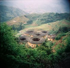 this would make an awesome earthship design. One of the most famous Hakka villages in Tianloukeng (WikiCommons)