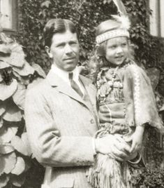 Crownprince Gustaf Adolf of Sweden with daughter, Pss Ingrid , Mids 1910s. Ingrid is wearing a native american costume. How cute!!