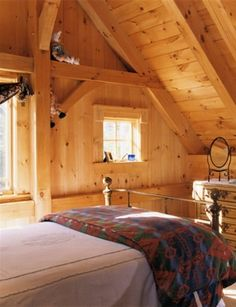 plank walled post and beam bedroom