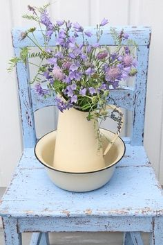 Pale purple flowers on a blue chippy chair.  So Sweet!