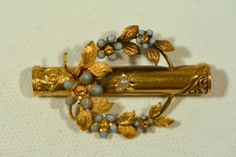 Early Victorian 14k Gold and enamel flowers brooch.