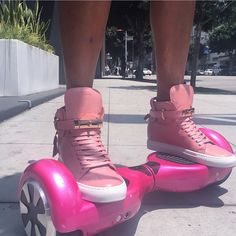 Pink buscemi sneakers and hoverboard
