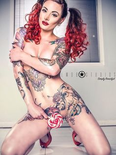 Meet some girls with tattoos in the most intimate of places. Our collection of women with tattoos below the belt are ready to show you their ink. From roses to butterflies, to one girl with the scr...