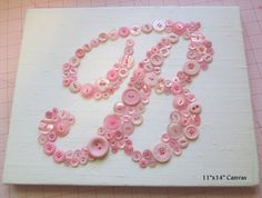 Why settle for a flat printed or painted monogram when you can have a shimmering button monogram? Made up of dozens of vintage and new