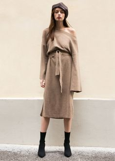 """Pullover,Soft Knit Dress w/Side Slits & Removable Belt Drop Shoulders.Relaxed Fit 60% Wool, 30% Tencel, 10% Cashmere 45"""" Length, 40"""" Bust Dry Clean Imported"""