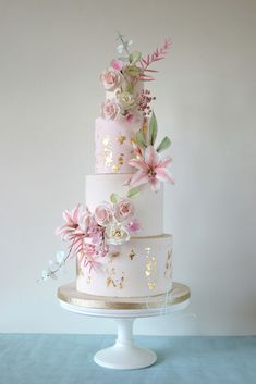 wedding cakes romantic Wedding cake iced in ivory and pale blush with distressed 24 carat gold leaf and a profusion of sugar flowers, including lilies, roses, cherry blossoms, snowberries and astilbe. Ivory Wedding Cake, Black Wedding Cakes, Elegant Wedding Cakes, Elegant Cakes, Beautiful Wedding Cakes, Gorgeous Cakes, Wedding Cake Designs, Pretty Cakes, Rose Wedding Cakes