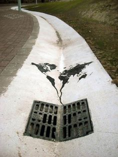Painted World Map Heading Down The Drain