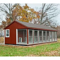 14x32 Kennel - Traditional Series - Board and Batten Siding, painted Red with White Trim and Bronze Metal Roof
