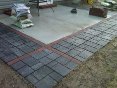 Concrete patio expanded with pavers/flagstones.  http://slickdeals.net/f/2931881-lowes-20-off-all-patio-blocks-stones-edgers-and-pavers?page=3