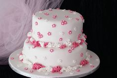 white cakes with pink flowers