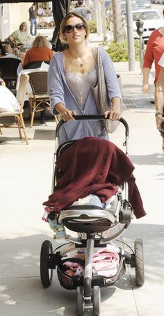 Victoria's Secret model Alessandra Ambrosio taking a stroll with her Quinny Buzz
