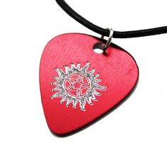 Supernatural Inspired - Engraved Red Guitar Pick With Anti Possession Symbol Hand Stamped Jewelry, Handmade Jewelry, Anti Possession Symbol, Supernatural Fandom, Zendaya, Leather Cord, Symbols, Inspired, Cool Stuff