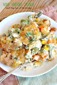 Mixed Vegetable Casserole uses mixed veggies of your choice, cream of celery soup, sour cream & cheese, topped with Ritz crackers. Great for holidays.