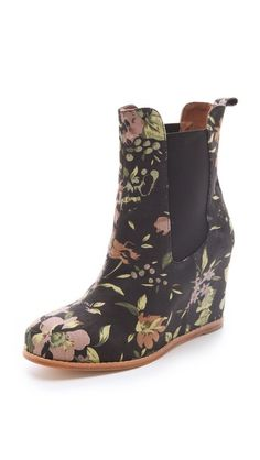 I love when I dig something soooo out of my realm...  Matiko Kain Floral Wedge Booties