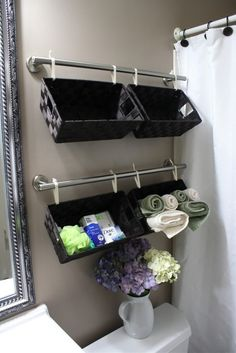 Inexpensive & cute bathroom storage. Towel bars, dollar store baskets & strong ribbon