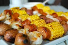 Shrimp Boil Kebabs    1/2 pound small new potatoes  2 small ears corn, cut into 1 1/2 inch rounds  1/2 pound andouille sausage, cut into 1 inch rounds  1/2 pound large shrimp, peeled and deveined   1/2 stick butter, melted  4 teaspoons Tabasco  2 teaspoons Old Bay Seasoning    Boil the potatoes in salted water over medium-high heat for about 12-15