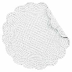 "Set of four quilted cotton placemats in white with scalloped edging.    Product: PlacematConstruction Material: CottonColor: WhiteDimensions: 17"" DiameterCleaning and Care: Machine washable"