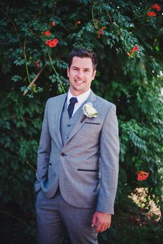 Love the wedding suit and boutonniere. Image by Tess Follet