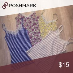 SALE 🎉 Set of four lace trim Old Navy tank tops Set of four lace trim tank tops.  Tan and white stripe, blue and white stripe, purple floral and yellow floral designs.  Old Navy. Old Navy Tops Tank Tops