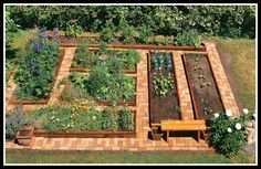 If ever I have a veg patch I would love it to look like this-Steppin' paver paths. Beautiful!