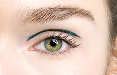 Eye makeup at Marchesa Fall/Winter 2014 created by Gucci Westman using Revlon Colorstay Skinny Liquid Liner (available spring 2014).