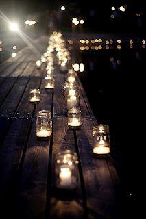 mason jar luminaries on dock