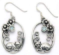 Sterling Silver Cat in Floral Oval Frame Wire Earrings with Faceted Blue Crystals    Lets face it we all love cats.  You can show your passion for cats by wearing cute cat jewelry for women.  You will find all kinds of pretty kitty jewelry that you will absolutely love.  If you are a statement necklace person then a cat statement necklace would be ideal.  I love the look of cat wrist watches along with some of the cute cat brooches and pins.  However cat rings and bracelets would make a…