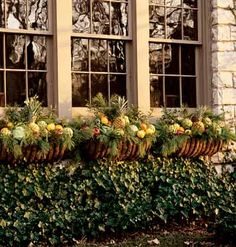 """""""The use of fruit in these window boxes, featured in Southern Living, makes this home stand out."""""""