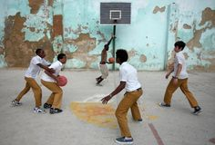 Teenage boys play basketball in school uniforms at a playground in Havana Vieja. | Ph: Erika Schultz
