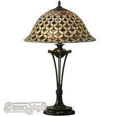 Tiffany Tafellamp Denia Large  Een bijzonder mooie tafellamp. Helemaal met de hand gemaakt van echt Tiffanyglas. Dit originele glas zorgt voor de warme uitstraling. De voet is bronskleurig. Met 1x grote fitting (E27) Max 60 Watt. Met schakelaars aan het snoer. Afmetingen: Hoogte: 65 cm Breedte: 40 cm Diepte: 40 cm