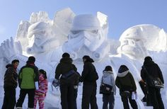 Photo by EPA / KIMIMASA MAYAMA. People stand in front of a snow sculpture of 'Star Wars' at the 66th Sapporo Snow Festival in Sapporo, northern Japan, 05 February 2015, the opening day of the mid-winter festival. Snow and ice sculptures are displayed at three venues, mainly at Odori Park. The amount of snow transported for the festival is equivalent to 6.500 five-ton trucks.