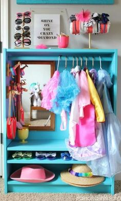 Transform an IKEA BILLY Bookcase into a bright blue wardrobe with space for clothes and accessories.