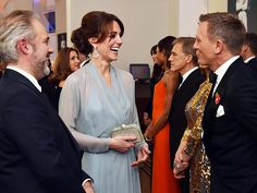 Catherine Duchess of Cambridge talks with Daniel Craig while attending The Cinema and Television Benevolent Fund's Royal Film Performance 2015 of the James Bond Adventure, 'Spectre' at Royal Albert Hall in London, England (October