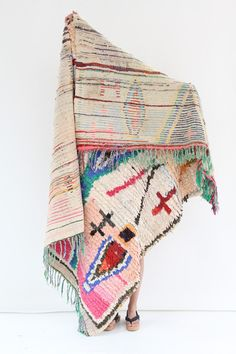 Morocco's Berber craft Boucherouite rugs. Can also be hung on walls. Authentic vintage rugs that make a colorful and warm statement. Made from sustainable mater