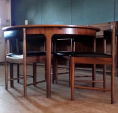 McIntosh Extending Circular Dining Table With Flush Fitting Chairs. Marvelous in a mid-century modern or contemporary interior. www.whittakergray.co.uk