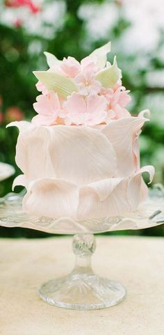 SO PREETY! Reminds me of dress Monica will be wearing. Cake in pale pinks and greens on a glass cake stand