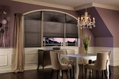 cellular shades on an arch with curtain panels