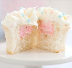"""Vanilla Reveal Cupcakes. """"These vanilla cupcakes aren't just tasty – they also contain a happy surprise for the parents-to-be. A blue or pink filling will reveal whether the baby on the way is a boy or a girl."""" (TomKat Studio for Pottery Barn Kids)"""