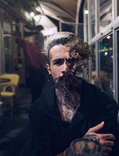 Cal Redback, manipulates photos of people and nature, joining them into one. He shows pieces of nature; parts of trees, moss, and plants growing out of peoples faces. It is as disturbing as it is interesting- making you not want to look away.